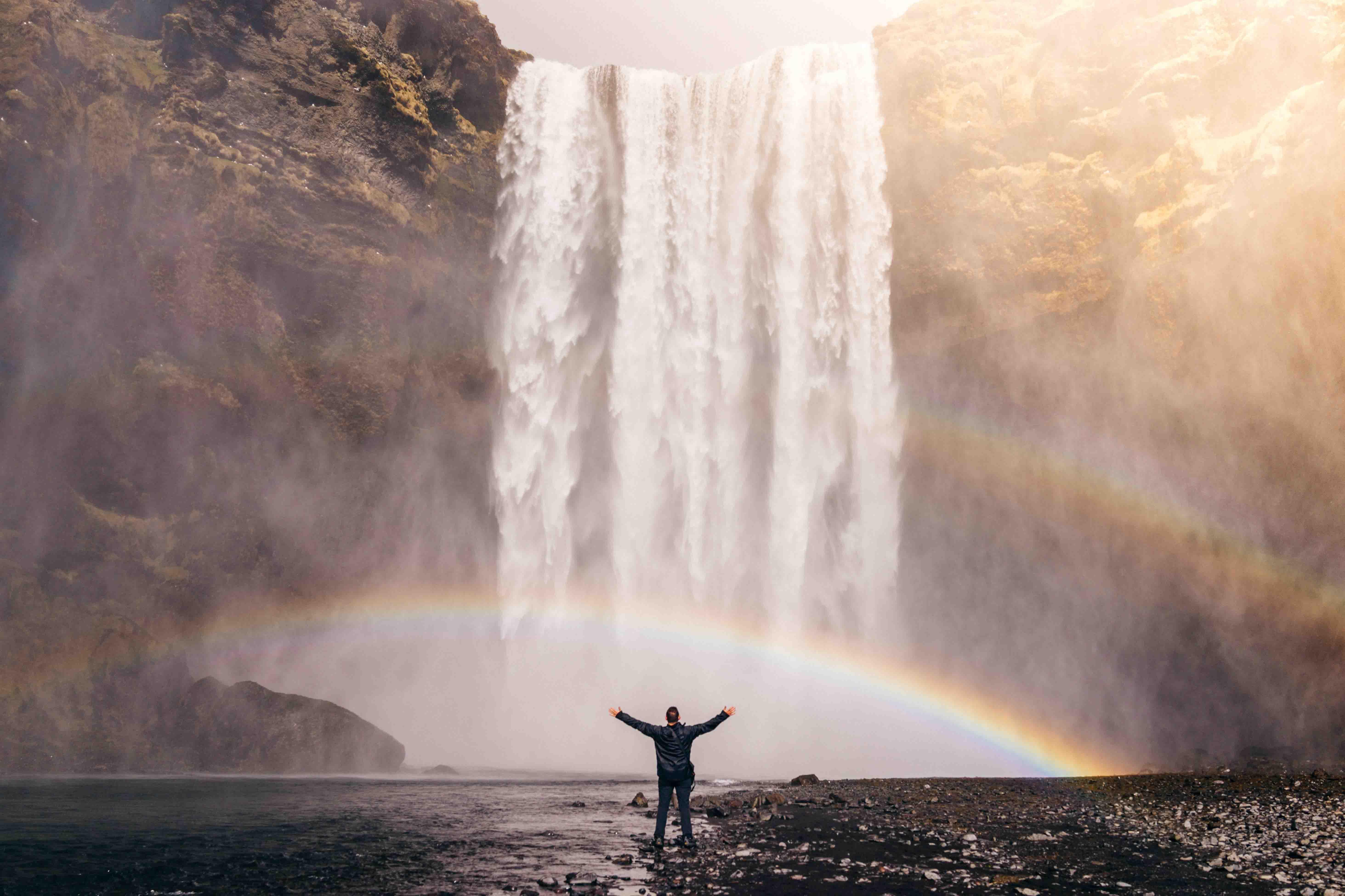 Man Before Waterfall